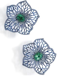 An impressive pair of titanium, emerald and diamond flower earclips ~ Each flower set to the centre with an oval mixed-cut emerald, total weight approximately 12.03ct, to undulating petrol blue...