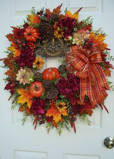 Fall and autumn fleur des leis wreath. Tuscan style.    http://www.timelessfloralcreations.com/