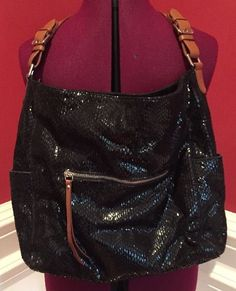 Gorgeous slouchy bag with top zip, front zip pocket, two side magnetic snap pockets, one interior zip pocket and two open interior pockets for cell phone. Shiny black leather with brown leather strap. | eBay!