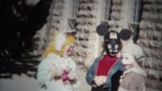(8mm Film) Halloween Costumes Outside of School 1955. http://www.pond5.com/stock-footage/50310832?ref=StockFilm keywords:16mm, 2160, 3840, 4k, 50s, 8mm, Americana, amateur, archive, cinematography, classic, clips, costume, cuts, edits, film, footage, golden age, grainy, halloween, home movie, home video, homemade, innocent, kids, memories, nostalgia, old, preserve, projector, reel to reel, restore, retro, romance, school, super 8, uhd, vintage