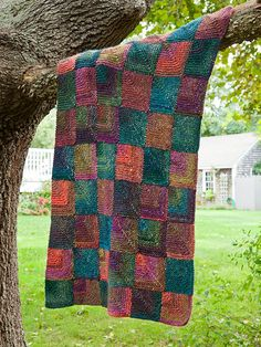 Putnam FREE knitting pattern — Self-striping Lodge lends eye-catching color to this throw made of mitered squares. Knitting Patterns Free, Free Knitting, Crochet Patterns, Free Pattern, Knitting Squares, Afghan Patterns, Square Blanket, Afghan Blanket, Knitted Afghans