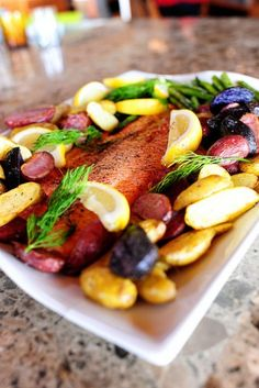 Roast Salmon with Potatoes, asparagus, and lemon-dill-caper drizzle.