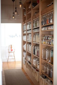 I really want a walk in pantry.  This image is immensely satisfying.  I really want a solution like this with shallow shelves.