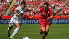 EDMONTON, AB - JUNE 06: Allysha Chapman #15 of Canada and Wang Lisi #21 of China PR battle for the ball during the FIFA Women's World Cup Canada 2015 Group A match between Canada and China PR at Commonwealth Stadium on June 6, 2015 in Edmonton, Alberta, Canada. (Photo by Maddie Meyer - FIFA/FIFA via Getty Images)