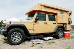 This Jeep JK Wrangler was topped with an interesting slide-in ...
