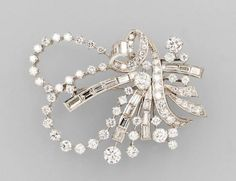 Brooch, ribbon shaped with diamonds, WG 750/000, 69 brilliants total approx. 5.0 ct, 18 diamond baguettes total approx. 2.80 ct TopWesselton/vvs-vs, total approx. 16.4 g, approx. 5 x 4 cm, significant for the period ribbon shaped 1950s  Estimation 3.200€