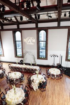 The Bell Tower is such a beautiful venue that you don't need a lot of decor. This couple chose to play up the walls with their monogram in lights! Click the image to learn more. Photo credit: Frozen Exposure Photography & Cinematography