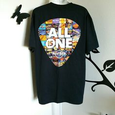 """Hard Rock """"Treasures of the Hard Rock"""" Tee Awesome rare tee! Black adult tee with short sleeves. On the front it says """"Treasures of the Hard Rock"""" and on the back it says """"All is One"""". Colors are vivid on the back of this tee with a guitar pick collage of locations featuring diferent styles of the hard rock logo. Hard to find, collectable. Material is cotton.   Size is XL  Bust: Approximately 47"""" Length: Approximately 31.5""""  New without tags.  $$ FINAL PRICE Hard Rock Tops Tees - Short…"""