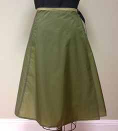 Rain Wrap. Over your skirt. Easy on off. Way easier and cooler than the pants.