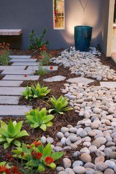 Rock Garden idea -  mix of river stones and stone tile.