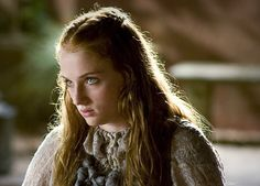Sansa Stark from Game of Thrones giving her 'Prince Joffrey will die' look.