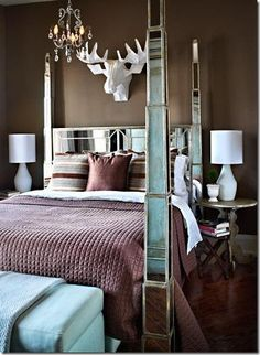 Guest room .. Love the moose with chandelier