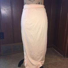NWT HIGH WAISTED PENCIL SKIRT IN SZ S NWT BEIGE HIGH WAISTED PENCIL SKIRT IN SZ SMALLIT HAS A BACK ZIPPER, banded waist and back slit.‼️‼️its sized a small but I think will fit a med better.  Material has stretch in it!!‼️ Skirts Pencil