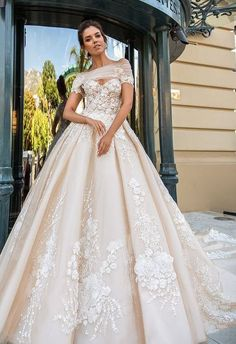 Uniquely glamorous floral lace applique ballgown wedding dress; Featured Dress: Crystal Design