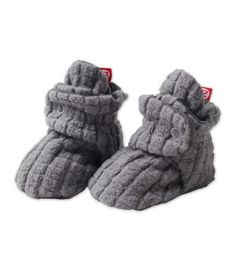 Cozy Baby Booties. Whether bundling up in winter months or keeping those toots warm when flying on a plane, these stay on newborn feet better than most socks and are way more comfy than any shoes. Highly recommend. They have ones with grippers on the bottom for early walking days too.