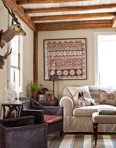 I like the blending of styles - rustic and feminine. I also like the sweet Smooth Fox Terrier pup. :)