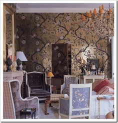 Nicky Haslam - Chinese wallpaper dining room with jib door