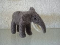 Needle felted miniature elephant  free shipping by FeltedByRikke, $21.00 she has a nice collection of little animals