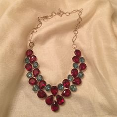 """STATEMENT NECKLACE Red and blue topaz faceted stone necklace in silver plated casting. Unique piece. Measures 6"""" from top red to red jewel. Measures about 5"""" top jewel to center bottom. Very comfortable to wear and just the right sparkle in beautiful colors Jewelry Necklaces"""