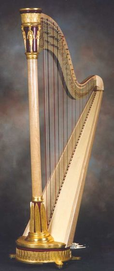 """Custom built harp by H. Bryan & Co., for a client who wanted a """"Medieval Egyptian"""" theme. Ornaments are based in part on those of an Erard Grecian."""