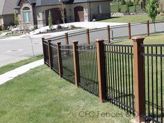 Image from http://www.fenceutah.com/wp-content/gallery/trex-with-iron/trex-posts-with-iron-fence-18.jpg.