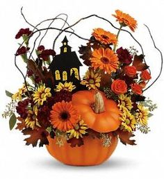 This hauntingly cute arrangement brings the Halloween spirit to life with a seasonal assortment of fresh flowers, topped with a ghostly haunted house. It's hand-delivered in a charming ceramic pumpkin jar that's sure to become a fall decor staple!