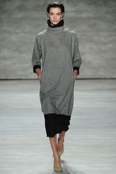 Tome Fall 2014 RTW. #Tome #Fall2014 #NYFW sweater dress. funnel neck layered over turtleneck. mid-calf dress/skirt under sweater dress. grey and black. raw. minimal.