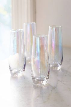 Shop Iridescent Stemless Flute Glass - Set Of 4 at Urban Outfitters today. We carry all the latest styles, colors and brands for you to choose from right here.