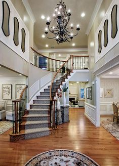 A step down foyer features a staircase with balusters of for 2 story foyer conversion