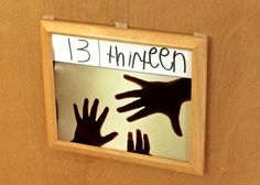 Make number cards using the students' hands/fingers (it looks like the image was taken against a light board)