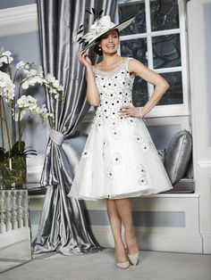 A stunning Mother of the Bride & Mother of the Groom dress from the Portofino High Summer 2016 Collection by Ian Stuart London. This ivory dress has been beautifully designed using a silk dupion fabric which features black organza flowers across the dress. Product code ISL672. View more Mother of the Bride / Groom dresses from our Ian Stuart collection at: http://www.baroqueboutique.co.uk/mother-of-the-bride-south-wales/ Photographs courtesy of: http://www.ianstuart-london.com/