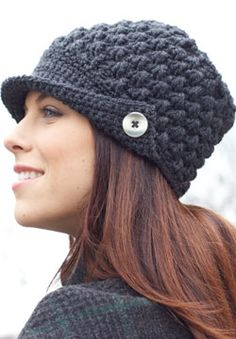 With a buttoned flap and crocheted construction, this chic peaked cap is a cool-weather staple. Shown in Patons Canadiana.