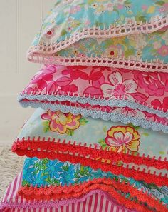 Crocheted edged pillowcases. Love the bright, cheerful colors. They are so pretty...makes me want to learn how