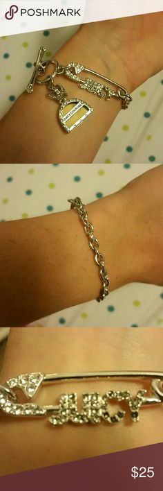 Juicy couture bracelet Safety pin Tiffany style chain bracelet. Never actually worn, however there is some discoloration on a few of the small diamonds (they are still there, not missing). Received as a gift and just not my style. Reasonable Offers welcome. Juicy Couture Jewelry Bracelets