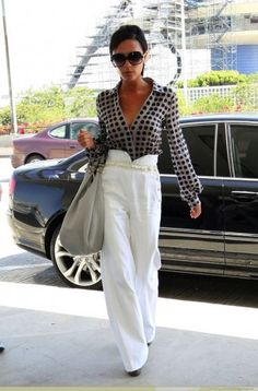 Victoria Beckham - white trousers/printed blouse.....timeless