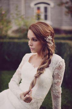 I love it all! Lace sleeve wedding dress. Braid. Flower.