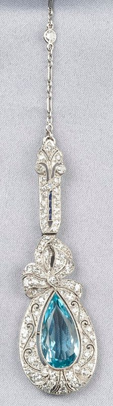 Art Deco, Platinum, Aquamarine, and Diamond Pendant, bezel-set with a pear shaped aquamarine measuring approx. 17.80 x 8.60 x 5.35 mm., framed by single-cut diamond melee and french-cut synthetic sapphires, suspended from trace-link chain with bezel-set old mine-cut diamond melee, approx. total diamond wt. 2.03 cts., completed by a navette shaped clasp, millegrain accents, lg. 30 1/2 in.