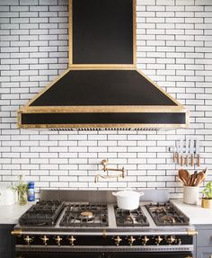 black and brass range, subway tiles