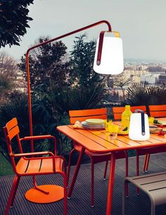 Elegant, modern, practical outdoor furniture by Fermob. Luxembourg Table and Chairs with new Balad Lamp outdoor lighting with stand.