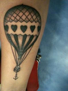 Hot Air Balloon Tattoo. I like the design on the balloon and the anchor at the bottom.