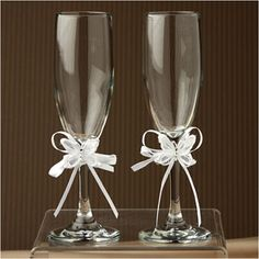 "Toasting Flutes - Radiant Butterfly - WeddingDepot.com - 252-K626 Add a special touch to your wedding reception and to your cake table with these toasting glasses.  Set includes two toasting glasses measuring approximately 8.5"".  Each flute is accented with a bow that you can incorporate into your wedding theme.  Bows are available in white or ivory."