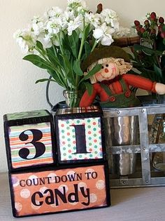 DIY Wood Advent Calendar...I would love to make one of these for Christmas instead of Halloween!