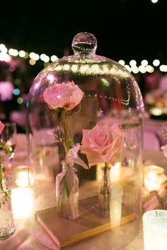 Beauty and the Beast centerpieces. i love this so much more than using a normal vase.