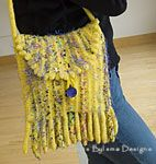 "Goldilocks Bag: Fabulous felted tresses and a picot edge adorn this bag with a built -in security system: Who would dare steal such a show stopper!  Sizes: 9 ½"" wide x 12"" high  Gauge: 3 sts/inch on US 13/ (needles before felting)"