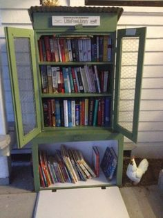 """We decided to build a library that reflected our small community. A chicken coop theme fit us perfectly! We took an old bookcase, put on Plexiglass front doors, mounted it on a sturdy box, added a rusty tin metal roof and it became our library. Lighting and fans make it comfortable and convenient for all seasons."" Margaret Atkins, Winchester, TX"