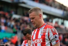 Stoke City's English defender Ryan Shawcross reacts as he leaves the pitch after the English Premier League football match between Stoke City and Arsenal at the Bet365 Stadium in Stoke-on-Trent, central England on May 13, 2017. Arsenal won the game 4-1. / AFP PHOTO / Lindsey PARNABY / RESTRICTED TO EDITORIAL USE. No use with unauthorized audio, video, data, fixture lists, club/league logos or 'live' services. Online in-match use limited to 75 images, no video emulation. No use in betting…