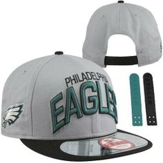 NFL Philadelphia Eagles NFL Reverse Arch Snap 9Fifty by New Era. $11.81. This 9FIFTY® cap features an embroidered (raised) Philadelphia Eagles team logo at front, stitched New Era® flag at wearer's left side, and a snapback closure for an adjustable fit. Interior includes branded taping and a moisture absorbing sweatband.