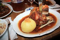 Schweinshaxe--- The Germans have a dish called schweinshaxe that is particularly popular in Bavaria. It is a roasted pig knuckle, and it will punch you in the mouth with its gastronomical awesomeness. Bavarian Recipes, Bavarian Food, German Meat, Food From Different Countries, Great Recipes, Favorite Recipes, Oktoberfest Party, I Chef, Pork
