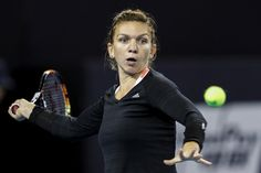 Simona Halep Photos Photos - Simona Halep of Romania returns a shot against Yanina Wickmayer of Belgium during the Women's singles second round match on day four of the 2016 China Open at the China National Tennis Centre on October 4, 2016 in Beijing, China. - 2016 China Open - Day Four