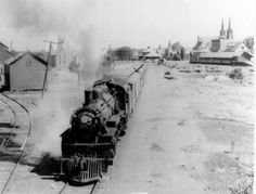 DSS&A no. 555 leaving Calumet with a passenger train.  The   Calumet passenger and freight depots are in the background  as well as St. Joseph, the Slovenian Catholic church, now called   St. Paul.  Photograph courtesy of Michigan Technological  University, Copper Country Historical Collections.